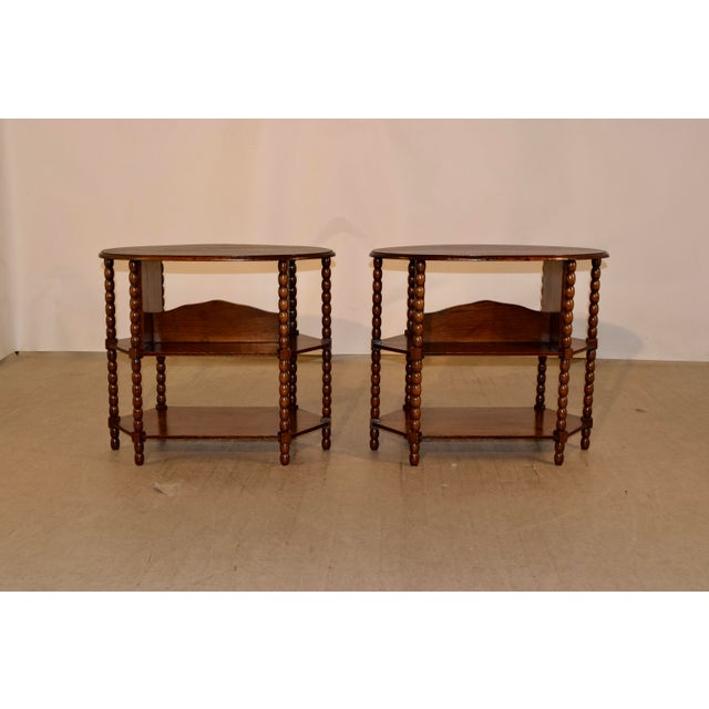 Pair of late 19th century oak side tables from England with oval tops which have beveled edges, following down to two...