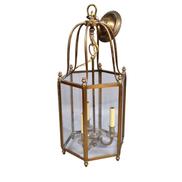 Rustic brass and glass hall lantern three light fixture. The core is made out of a brass stem, very detailed. Wired for...
