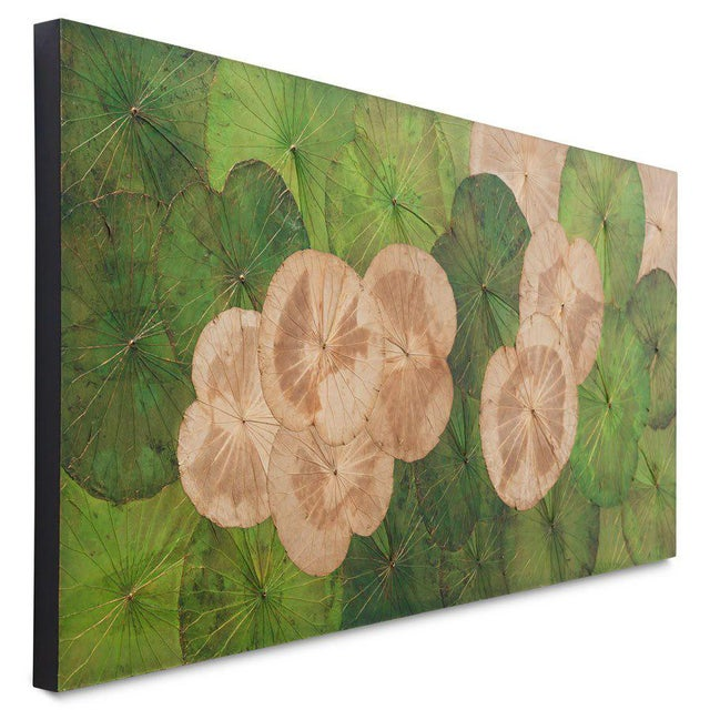 This is a genuine lotus leaf wall hanging. The piece was created in Thailand.