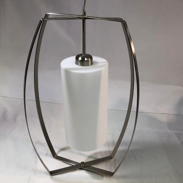 Capital Lighting HomePlace 1-Light Pendant - Showroom Sample This sleek light fixture is constructed of metal in a brushed...