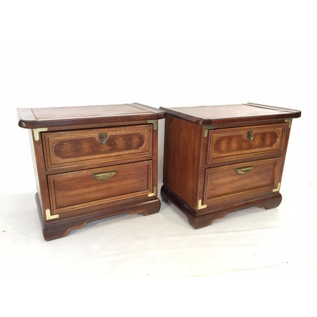 Pair of solid wood Ming style nightstands feature curved wing tops and brass campaign hardware. Very sturdy and...