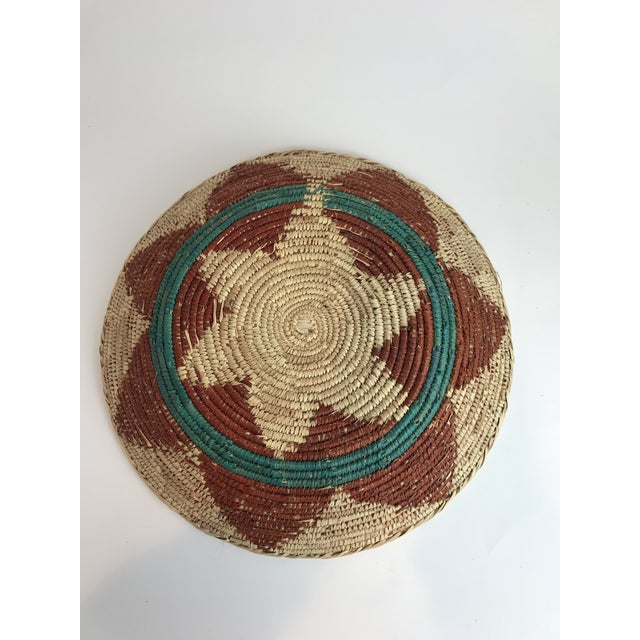 A woven basket in the style of the native Navajo wedding basket. Although not authentic Native American it uses the same...