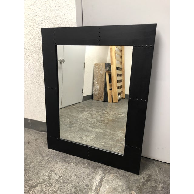 Design Plus Gallery presents a rustic style wall mirror. A wood frame wrapped with a thin metal sheet with decorative...