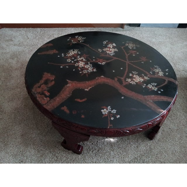Antique oriental red lacquer round table. Hand made and hand painted with artist signature. I added a protective glass...