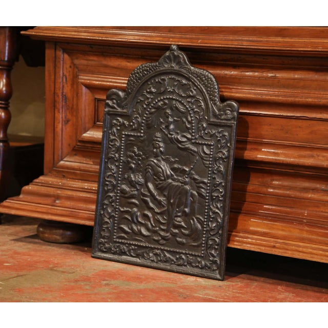 Use this fireback to decorate your fireplace or your stove in the kitchen. Crafted in France, circa 1860, the embellished,...