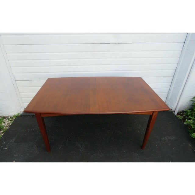 This gorgeous Dining Table is made of wood, solid wood, teak wood, and veneer, and is in good condition. This Table is...