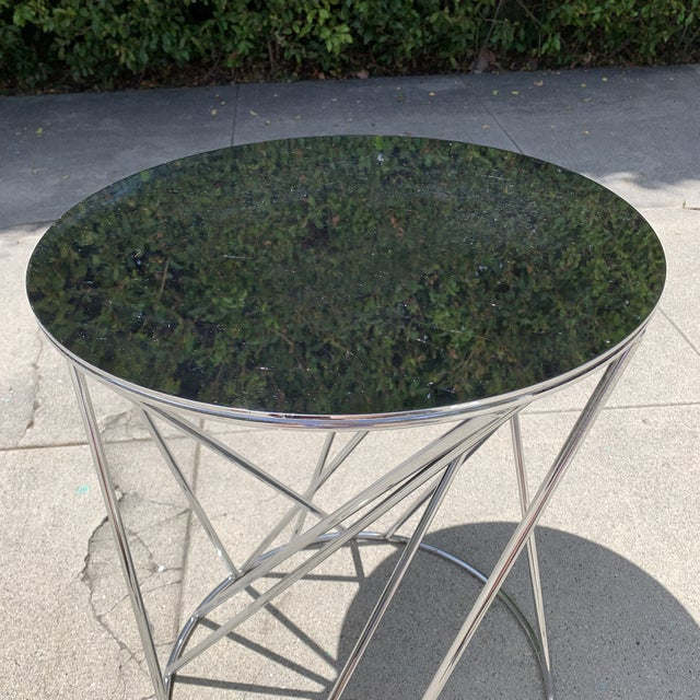 Chrome-plated West Elm random base side table. Made in the 2010s.