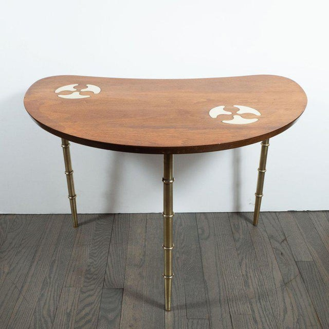 This refined Mid-Century Modern table was realized by the celebrated 20th century design firm, Mastercraft, in the United...
