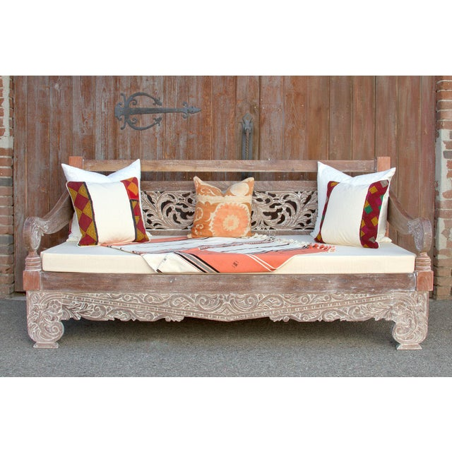 This sturdy carved whitewashed daybed is hand carved with scrolling floral design and made from reclaimed teak wood with...