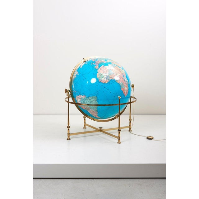 Wonderful and rare illuminated globe with a brass stand. The globe is rotating and adjustable in high.