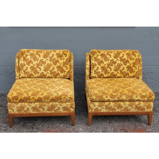 A pair of beautiful velvet fabulous 1950's original winged sided lounge chairs. Darker mustard ground with a darker toned...