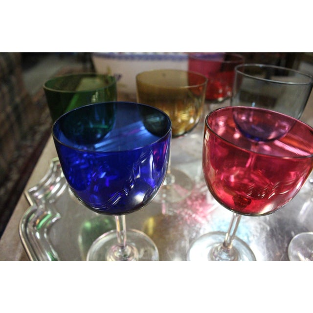 Small wine glasses in a variety of colors. Perfect for the eccentric art deco home.