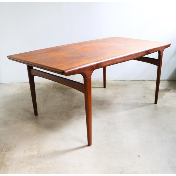 A rarely available Model 10 teak extending dining table designed by Niels Moller c.1958 and produced by JL Moller of...