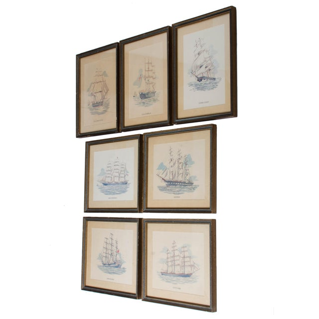 Set of seven vintage sailing ship framed prints. Featured ships are the U.S.S Constitution, Charles W. Morgan, Flying...