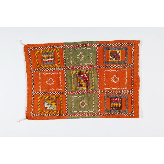 Hand-woven carpet from the Taznacht region of Morocco. Made using the highest-quality 100% sheep's wool. Featuring deep...