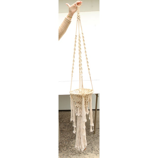 """Large vintage Boho Chic macramé hanging planter. This will fit a pot approximately 9"""" in diameter. Large and in great..."""