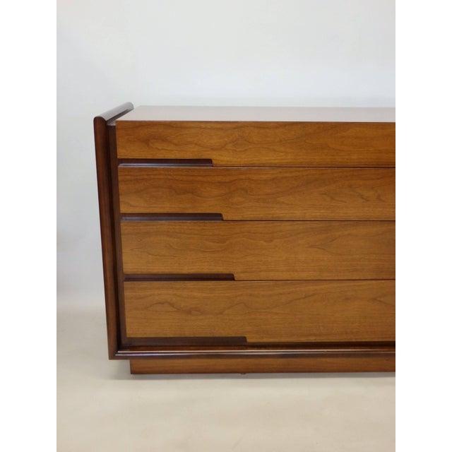 Long low dresser designed by Edmund Spence. Produced in Sweden.