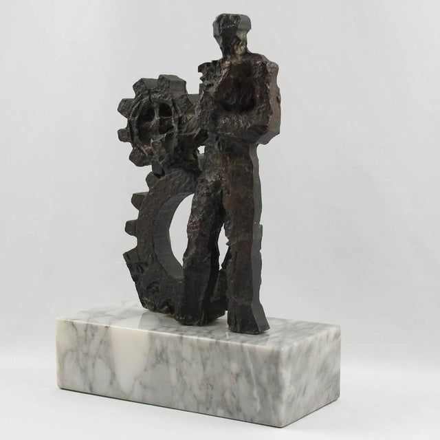Wonderful rare Mid-Century Modern brutalist bronze sculpture. Featuring an allegory of man and machine with beautiful...