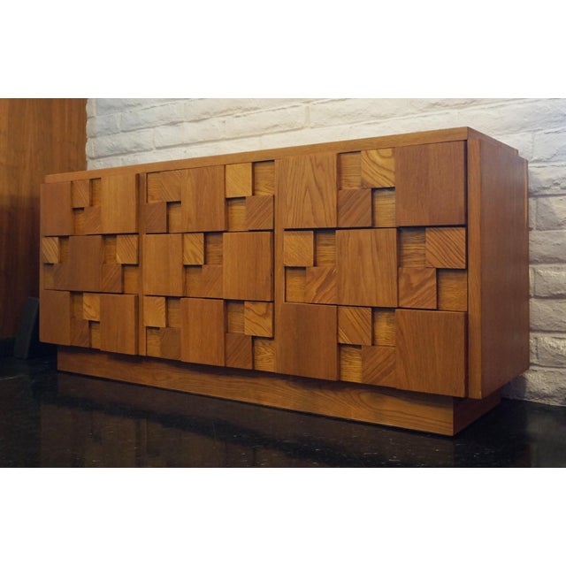 Manufactured in Altavista, Virginia Beautifully made geometric brutalist dresser by Lane. There are 9 drawers. Extremely...
