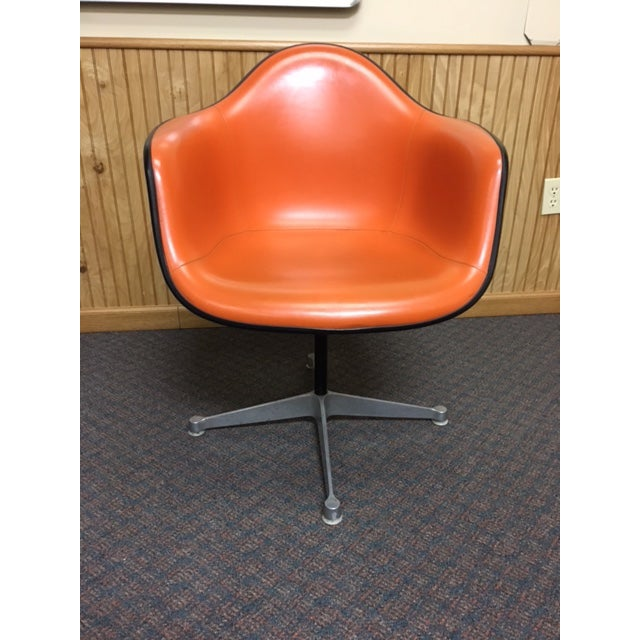 Herman Miller Eames Shell Chairs Gray/Orange Swivel Mid-Century Chairs in excellent condition, circa 1950. Orange vinyl...