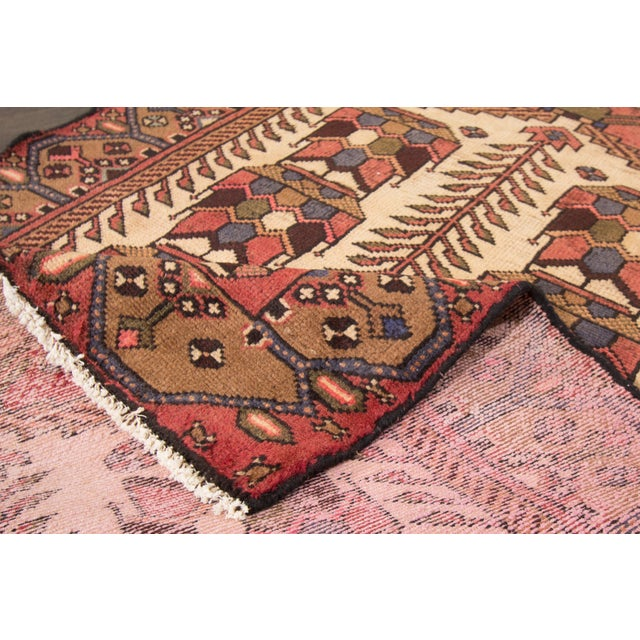 """A vintage hand-knotted Persian rug with an all over geometric motif. This rug measures at 3'4"""" x 4'10"""". Material: wool"""