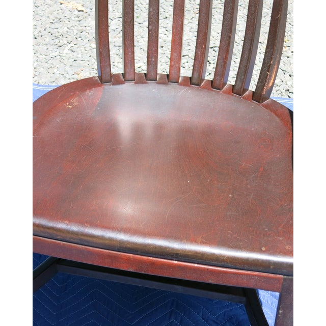 """Bankers chair, with red finish possibly mahogany. Wear to finish at armrests. Older chair finish worn. 25"""" wide x 24"""" deep..."""