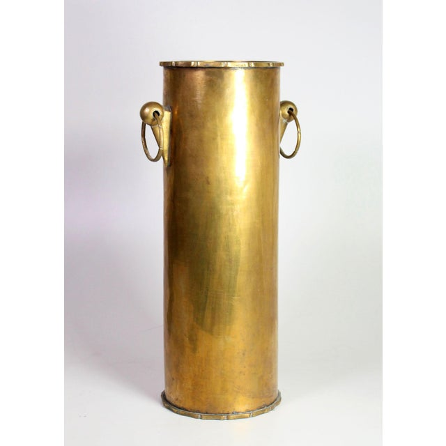 1960's solid brass umbrella stand with articulated faux bamboo handles and edges, left with some patina to show age.