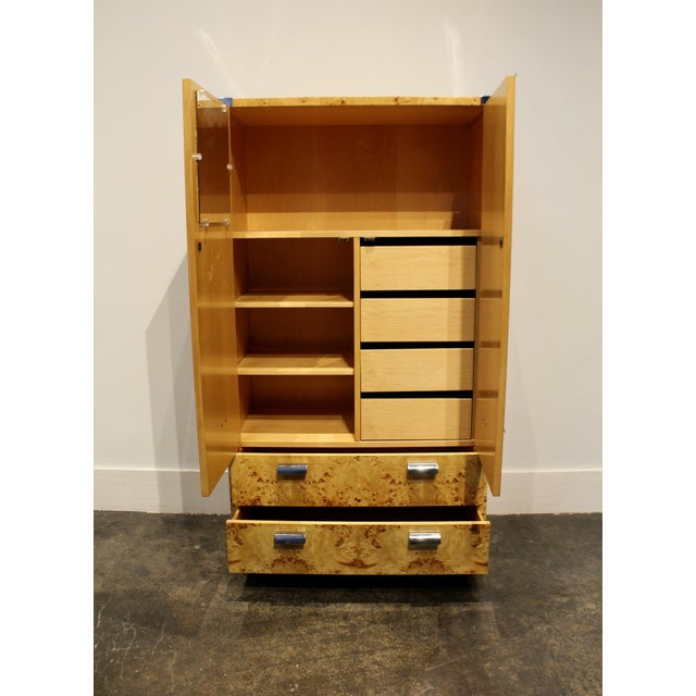 Modern wardrobe with beautiful combination of match-booked wood burl and rounded chrome elements. In excellent condition...