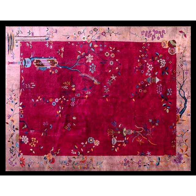 """This is a Chinese art wool rug from China 1920. The size is 9'x11'6"""". The colors are red, pink, blue, yellow, orange,..."""