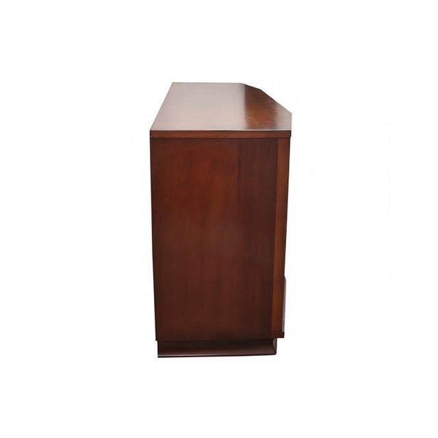 1960s Kent Coffey Perspecta dresser in solid Rosewood and Walnut. This dresser features an interesting con-vexed facade...