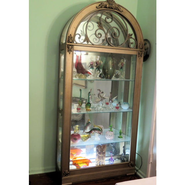 "This Monumental Hollywood Regency display case has 4, 1/2"" long shelves for display, with lights at the top and under the..."