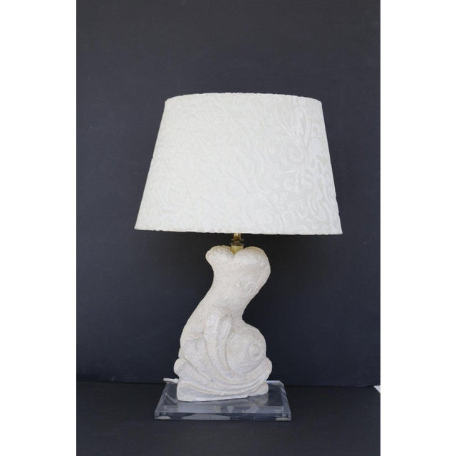 Many interesting textures with this beautifully carved stone lamp, in the shape of a dolphin. Lamp is on a Plexi-glass...