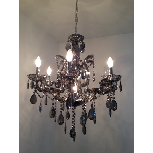 Reflective smoke glass, high glamour. This chandelier was in the home we purchased last year. The previous owner only...