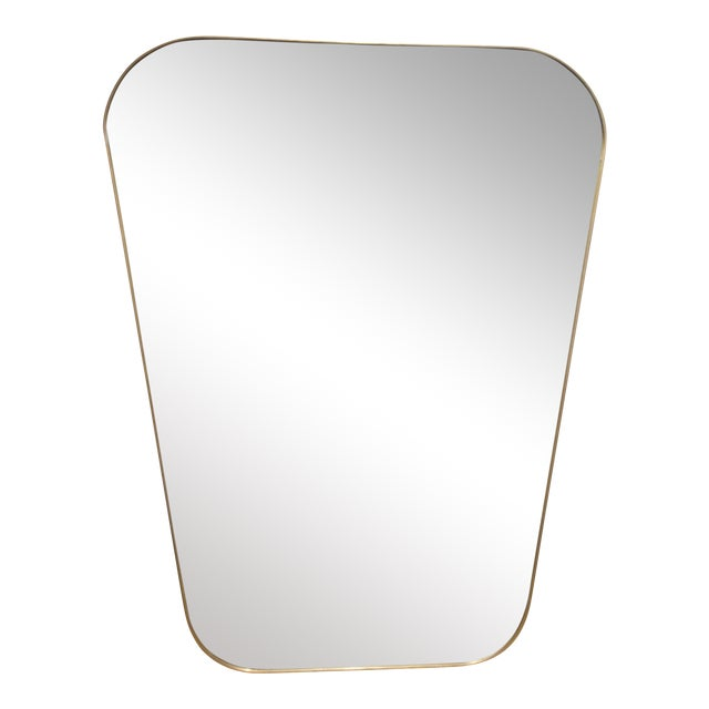 A stunning pair of trapezoid mirrors with a brass edge. Sold as a pair.