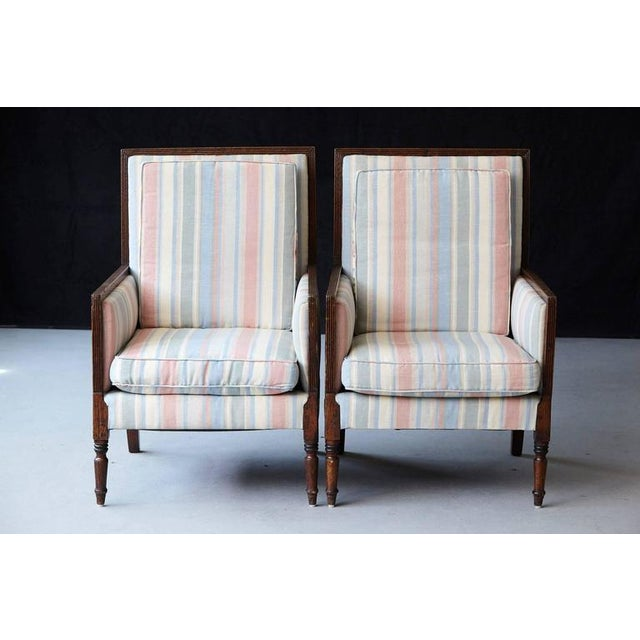 Beautiful pair of Italian neoclassical style bergères with a reeded frame raised on turned cylindrical legs. The...