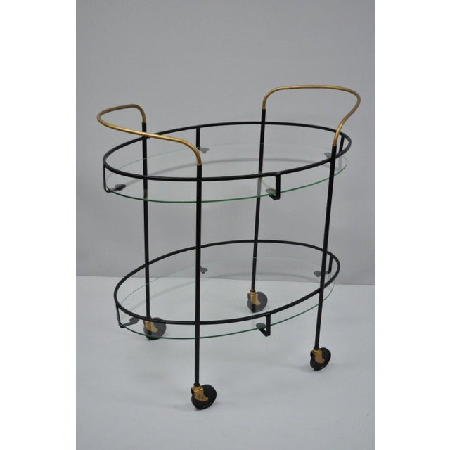 Wrought iron & metal frame, brass painted handles, nice oval shape, 2 oval glass tiers, clean Modernist lines, great style...