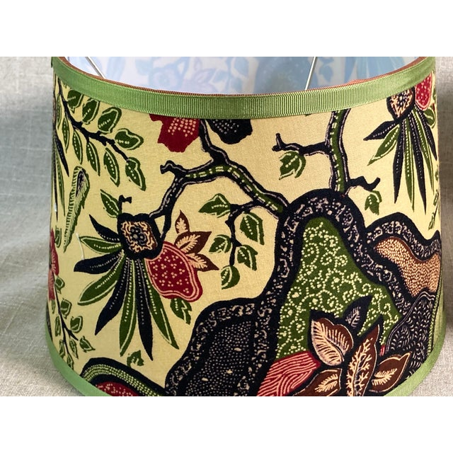 A Pair of lampshades handmade with a multicolored hand block printed cotton depicting stylized foliage. Measurements: top...