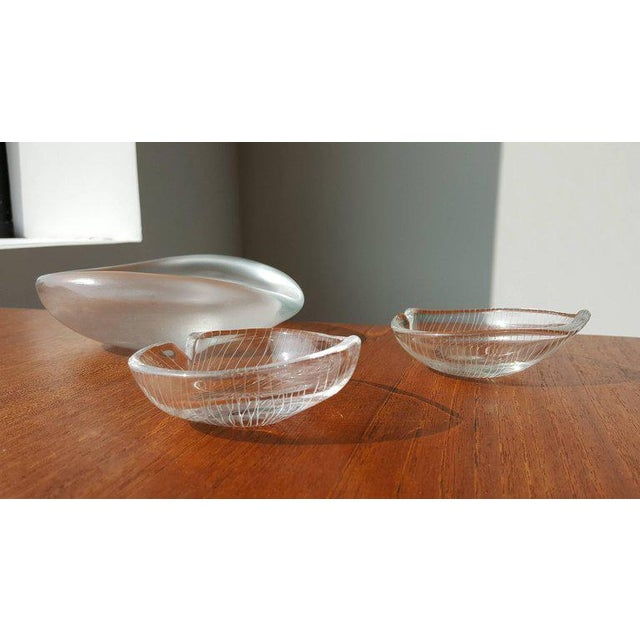 A nice collection of three vintage art objects created by Tapio Wirkkala for Iittala. The two smaller leaf bowls have a...