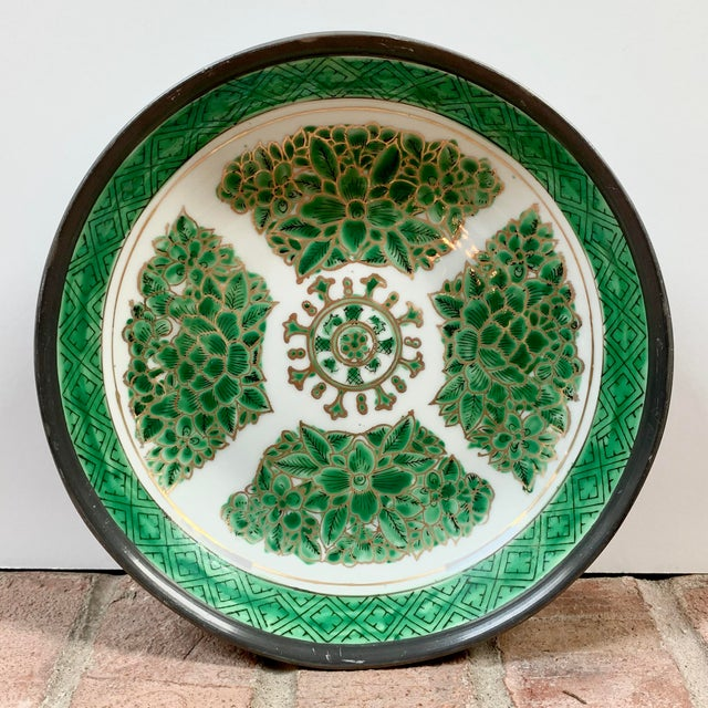 Bright emerald green floral design with gold accents hand painted on a white porcelain bowl encased in pewter. Made in...