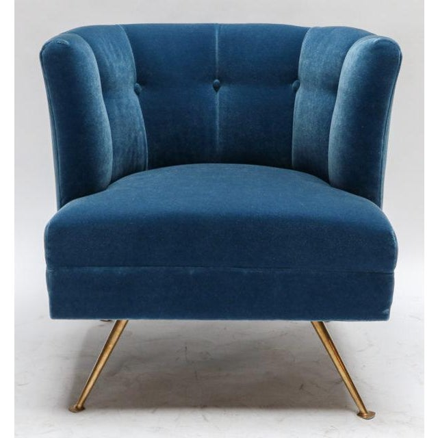 A pair of custom 1960s style Italian lounge chairs with brass legs, upholstered in blue mohair.
