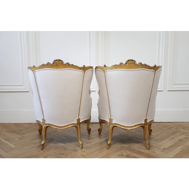 French Provincial Pair of Antique Giltwood Linen Upholstered Bergère Chairs For Sale - Image 3 of 13