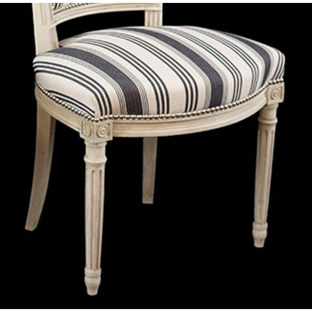 Handsome set of six louis xvi style side chairs covered in blue and white stripe cotton fabric with nickel nailhead trim.