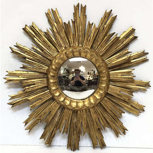 A lovely French gilt sunburst (or starburst) mirror, 21 inches diameter with round mirrored glass center in a moulded frame.