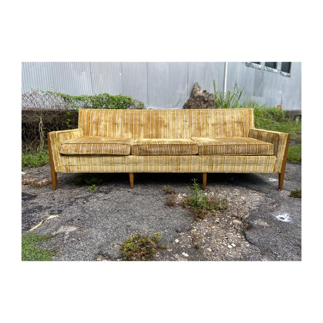 This three-seater can absolutely fit more than three people! This long and sleek sofa is a hard one to let go of!! Mid-...