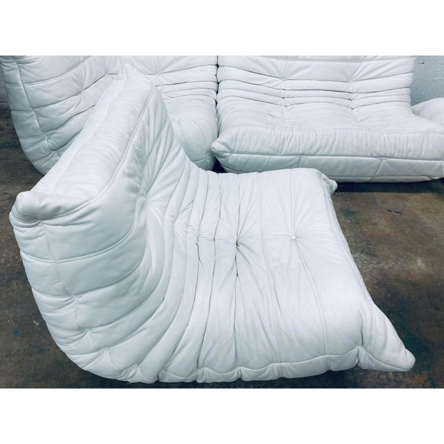 Two piece sectional Togo sofa in matte white leather. Designed by Michel Ducaroy for Ligne Roset, 1970s. Dimension: 1-Seat...
