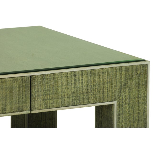 An elegant coffee table from the Century Furniture Purveyor Collection. Crafted of Beech Solids with Raffia. A single...