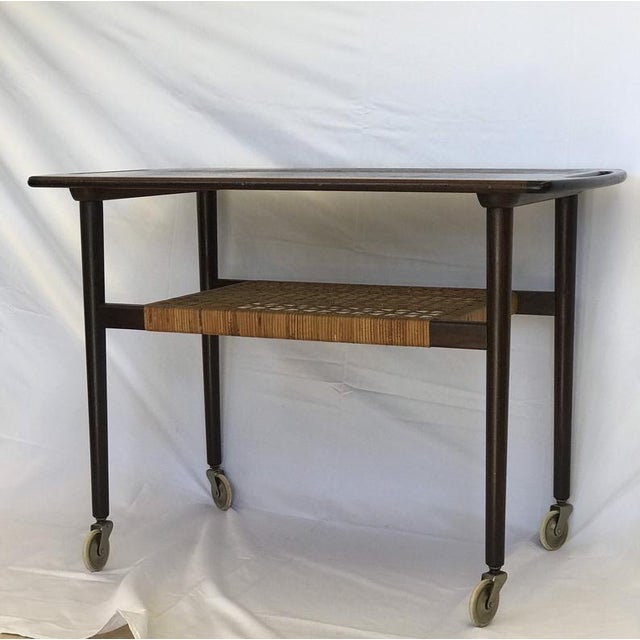 Beautiful rosewood table on casters. The table has a original paper cord self in good condition. Danish Design from the...