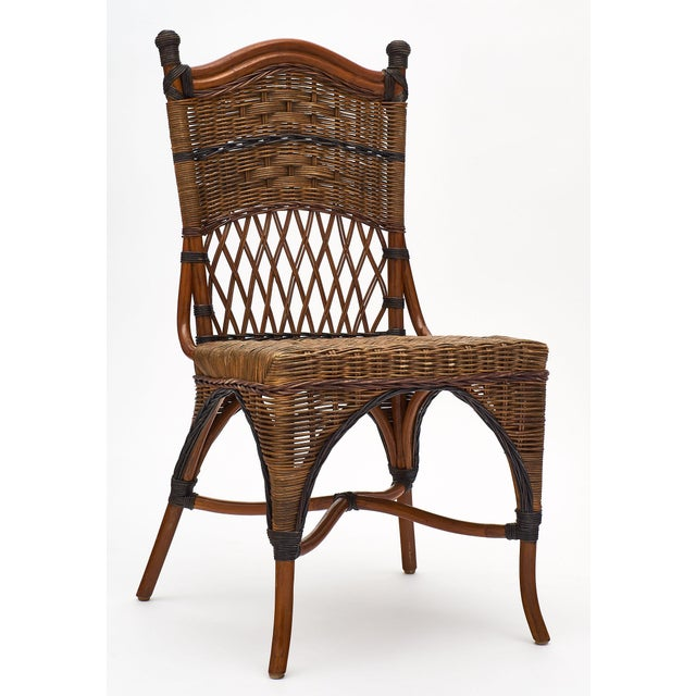 English wicker set of chairs and table in two-toned wicker. This set is in perfect condition and very comfortable. We love...