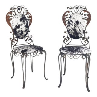 Forsyth One of a Kind Iron Garden Chairs Reupholstered in Brazilian Cowhide - A Pair For Sale