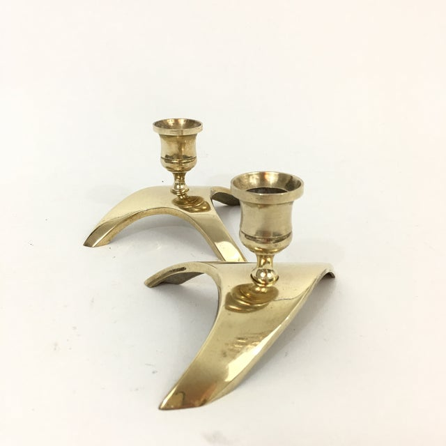 Mid century modern brass candlesticks with triangle shaped base. Brass is in excellent vintage condition. Perfect addition...